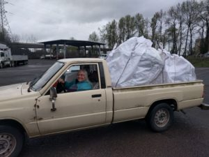 Bonnie in her truck with a load of recyclables